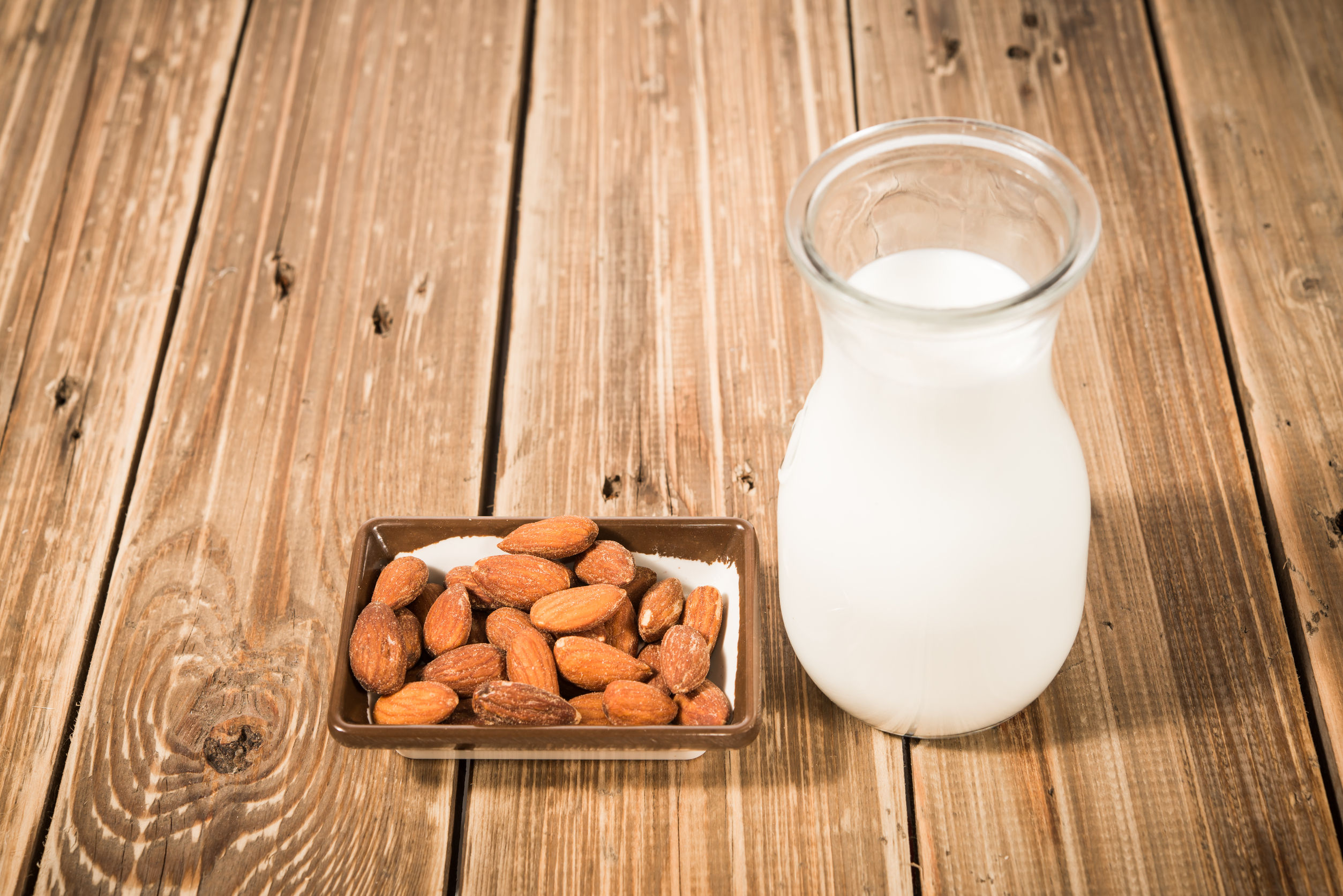 24925988 - almond milk in glass with almonds