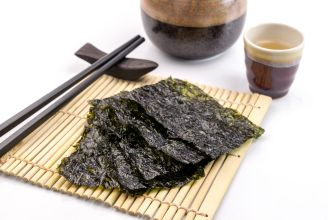 49987492 - roasted seaweed snack on bamboo mat