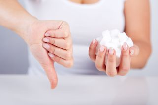 38744866 - woman holds in hand of sugar cubes