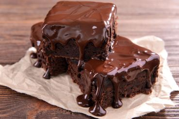 49652522 - delicious chocolate cakes on table close-up